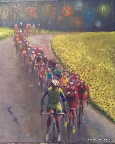 The peleton through the sunflowers